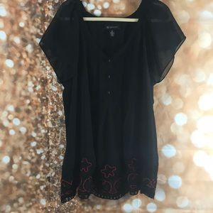 Tunic with embroidered and beaded details.